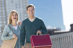 Mature couple shopping in city