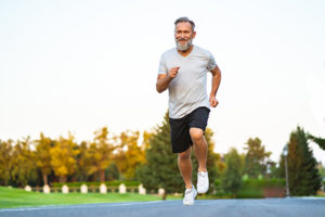 mature man running outside as an effective exercise for depression