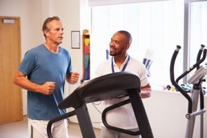 Man meeting with exercise physiologist during Cenegenics Health Evaluation, physician establishing baseline during Cenegenics evaluation