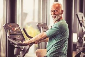 Man cycling for cardiovascular health, Vo2 Max Testing is the most effective predictor of long term health